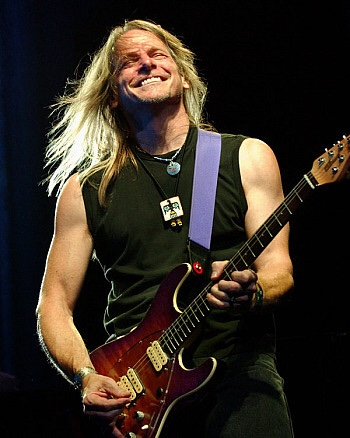 Steve Morse smiling. Onstage with Deep Purple.